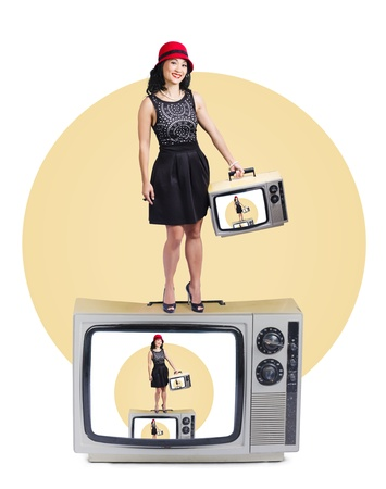Cute Asian woman enjoying fame on a retro television set photo