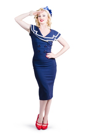 Young retro pinup girl with sexy blond curly hair style and beautiful makeup wearing sailor uniform, over white background photo