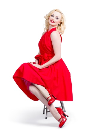 Isolated full-length portrait of a lovely woman in romantic red dress. Retro fashion model photo
