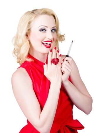 Fashion beauty portrait of a beautiful manicure and make-up woman showing off bright red nails and luxury makeup.  Nail polish concept photo