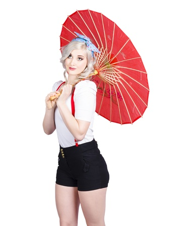 Smiling retro woman holding a red umbrella isolated on white Stock Photo - 21496328