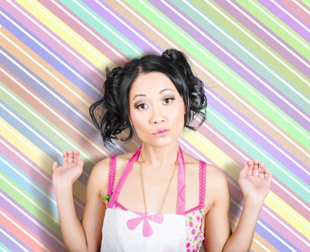 Surprised retro housewife on colorful stripe copyspace photo