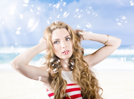 Close-up portrait of a beautiful girl wearing summer make-up with wind fluttering in her long wavy hair style photo