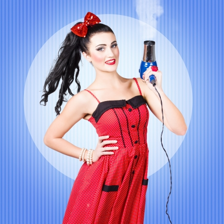 Cute 50s cartoon pinup girl shooting with hairdryer when getting a smoking hot blow dry and style. Beauty salon hair styling concept photo