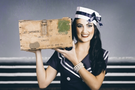 Retro maritime portrait of a beautiful woman wearing classic sailor fashion with elegant hair style and vintage make-up. Special forces delivery photo