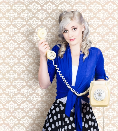 Retro portrait of a lovely woman talking on vintage yellow phone. Wallpaper copyspace  photo