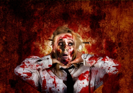 Scary zombie woman with expression of shock horror holding blood stained sore neck on red grunge wall Stock Photo - 22033346