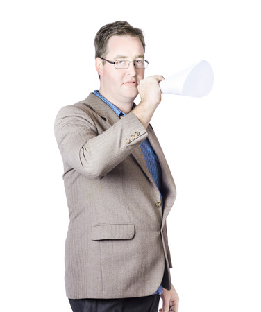 Isolated picture of a business man in suit making marketing announcement with megaphone photo