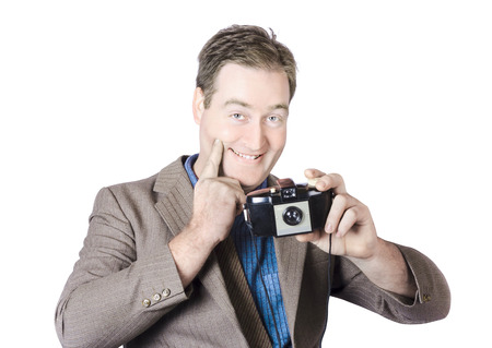 Isolated image of a funny man gesturing big smile while taking happy snap with vintage camera photo