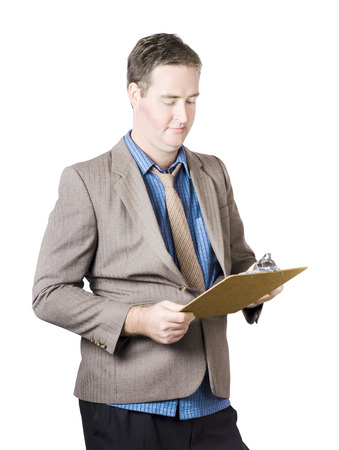 Business man conducting quality control audit when holding a clip board during a routine business inspection photo