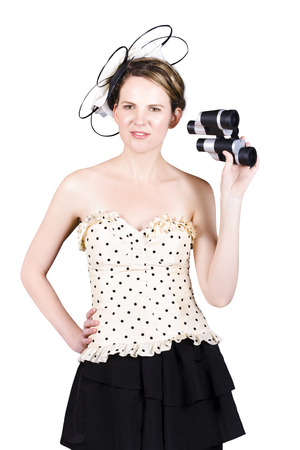 Portrait Of Young Beautiful Woman With Binoculars Isolated On White Background photo