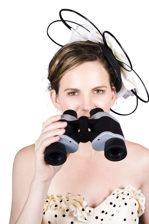 Beautiful Young Attractive Woman Holding Binoculars On White Background photo