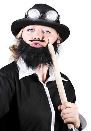 Woman Wearing Bowler Hat With Fake Beard And Mustache Holding A Large Pencil photo
