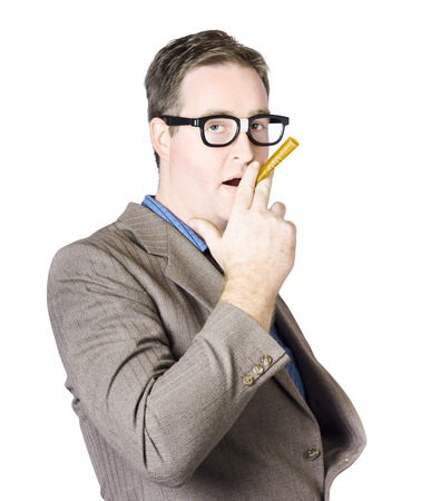 Mature Businessman Holding A Rolled Up Banknote Between Two Fingers In Front Of Mouth photo
