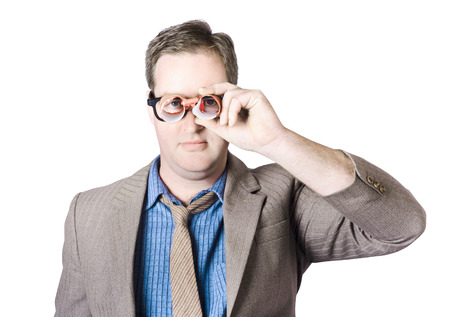 Nerdy Businessman Looking Through Handmade Paper Binoculars photo