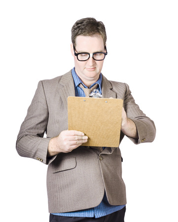 Businessman Reviewing Documents On Clipboard Over White Background photo