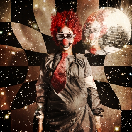 Crazy dancing disco clown on a psychedelic trip of distortion, raving underneath a spinning mirror ball in retro shades. Dr DJ photo