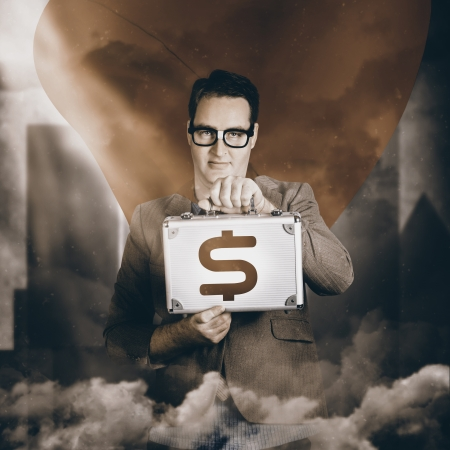 Classic vintage portrait of a superhero business man holding dollar sign briefcase in urban city sky. Investment returns photo