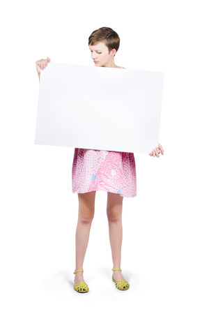 Woman looking down to read your text on blank advertising board on white copyspace photo