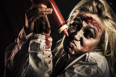 Shock horror food concept with a scary zombie woman out of tomato sauce at halloween party Stock Photo - 25670816