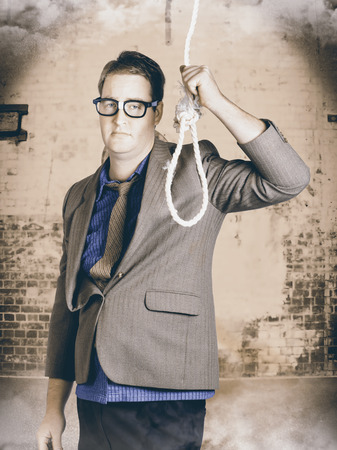 Manager business man holding noose rope at gallows. Failure and stress concept photo