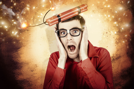 Comic portrait of a nerd businessman shouting out in fear from a stick of explosive dynamite being launched into the air Stock Photo - 28488074