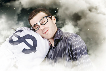 Funny finance portrait of a business person sleeping on a money bag in a cloudy haze of stars and sky. Investment security Stock Photo - 28488343