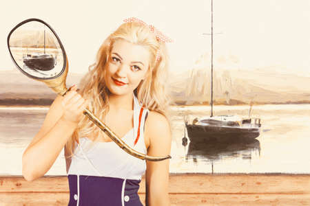 Vintage creative combination of painting, illustration, and photo manipulation of a beautiful blond sailor pinup girl holding maritime sightseeing equipment on boat deck. Pinup periscope Stock Photo