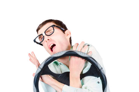 uncoordinated: Isolated accident prone man in the throes of a car crash impact. Uncoordinated drivers Stock Photo