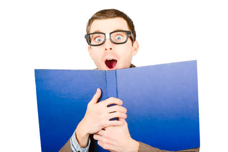 gasping: Isolated portrait of a comical book smart man gasping with a look of discovery inside open textbook. Learn to discover Stock Photo