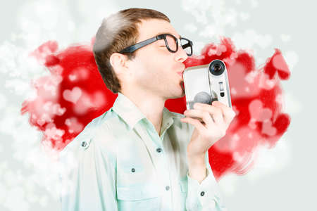 smooching: Humor inspired portrait of a director smooching on video camera during a film and television episode. Romance in film production