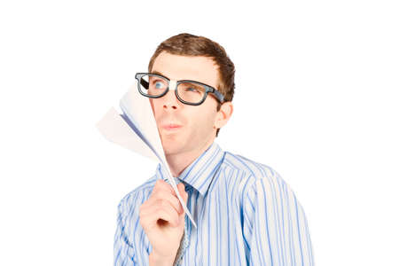 trajectory: Thoughtful smart business man devising trajectory plan while holding paper plane on white background