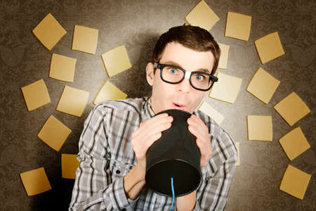 Office admin geek calling out a memo to workers on bulletin board background while noting feedback. Internal office communication. Stock Photo
