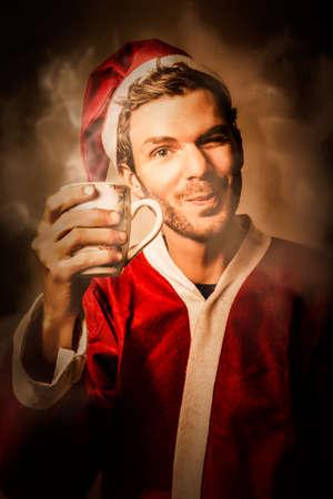 santa's helper: Santas helper taking a cafe break to drink hot christmas coffee in warm merry wishes of christmas cheers Stock Photo