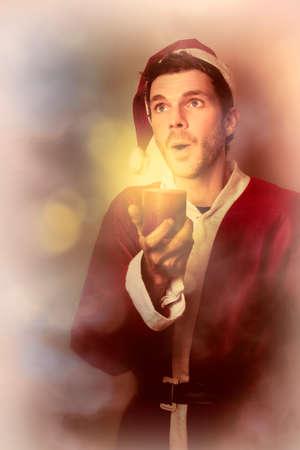 carols: Choir boy singing a christmas carol by flickering candle light on the night of xmas eve. Carols by candlelight