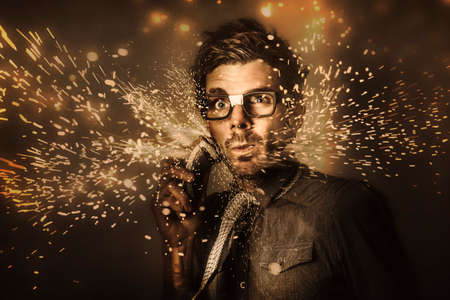 electric trimmer: Funny mens personal grooming concept on the face of a fashion man having a shave with electric beard trimmer in a grind of razor sharp sparks. Too hard for skincare products