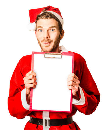 wish  list: Isolated portrait of a man in santa costume holding christmas wish list with smirk on white background