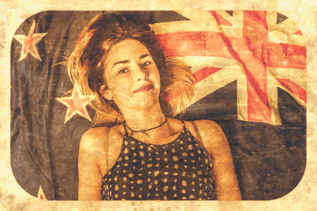 aussie: Vintage faded postcard with texture overlay and rounded edges of a Australian pinup girl celebrating Australia day at beach on flag towel. Old-fashioned Aussie insignia