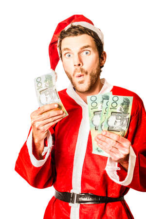 australian dollars: Isolated photo of a surprised santa holding Australian money while celebrating savings at christmas store sale in Australia