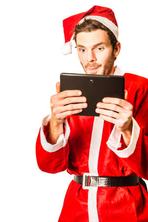 christmas movies: Isolated portrait of a santa claus man watching christmas movies on tablet technology. Festive gifts and devices