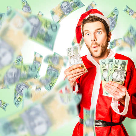 bank notes: Shocked santa claus holding Australia money when in a cash grab of one hundred dollar australia notes. Christmas win