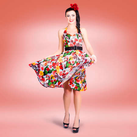 summer dress: Smiling brunette beauty spinning around while wearing a colourful summer dress Stock Photo