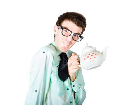rimmed: Young comical looking in thick rimmed glasses man holding white coffee pot decorated with red hearts isolated on white background