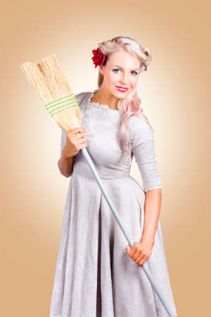 houseclean: Vintage woman holding old fashion broom when cleaning and tiding. Spring clean concept