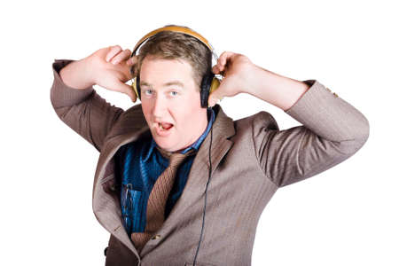 unwinding: Funny looking businessman bobbing to the sound of music in earphones on white Stock Photo