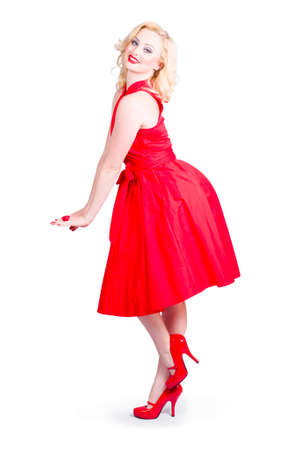 accouterment: Studio image of a beautiful woman model posing in elegant dress and red high heel shoes