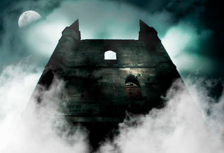 tower house: Spooky Is The Chilling Scene During A Horror Full Moon As Mist Rises From The Ruins Of A Old Haunted Castle Stock Photo
