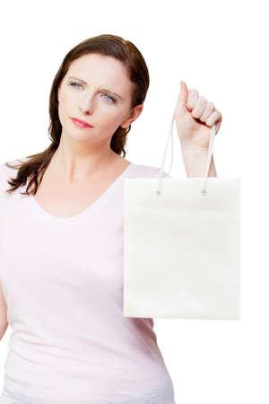 retail therapy: Woman with an idea of retail therapy thinking while holding shopping bags against white background, copyspace on department store bag