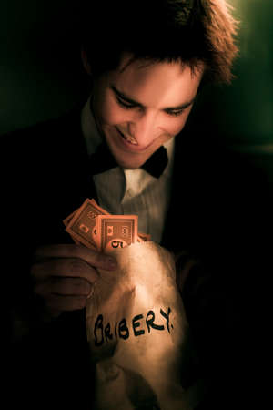 illicit: Dodgy Business Deal With A Fraudulent Politician Or Figure Of Authority Looking Into A Bag Of Money In A Representation Of Illicit Deceit And Immoral Behavior