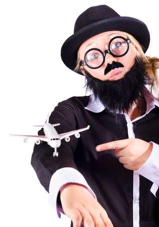 disguised: Woman disguised as man with false beard and airplane on arm, business travel concept